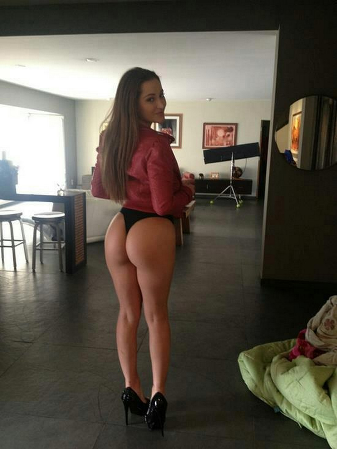 white girl poking booty back at the camera